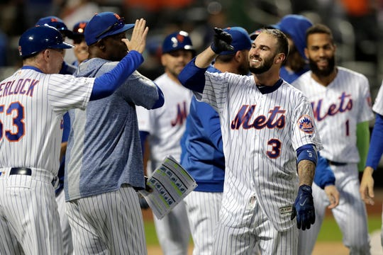 New York Mets' Tomas Nido (3) celebrates after hitting a walk-off solo home run to beat the Detroit Tigers, 5-4, in 13 innings Saturday, May 25, 2019, in New York.