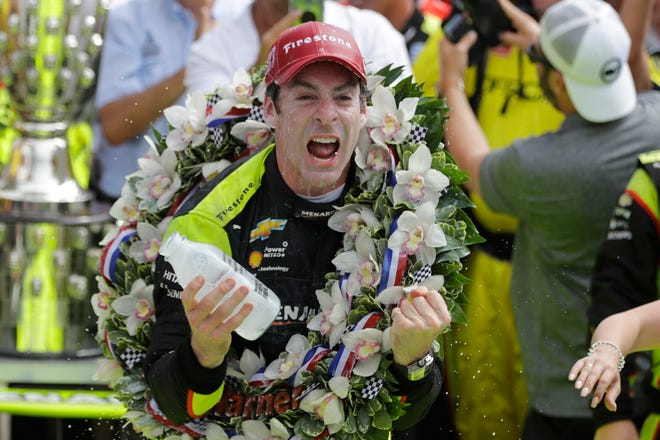 Simon Pagenaud celebrates after winning the Indianapolis 500.