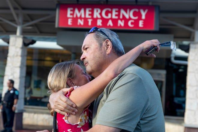 Sarah Haynes, left, embraces John Eller, father of Amanda Eller, outside the Maui Memorial Hospital on Friday, May 24, 2019 in Wailuku, Maui.