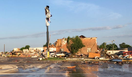 Debris lies on the ground at a motel after a deadly storm moved though the area in El Reno, Okla., on Sunday.