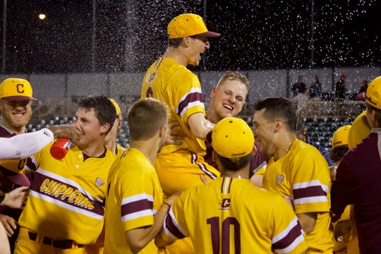 The Central Michigan baseball team celebrate after winning the program's third MAC tournament title with a 6-0 win over Ball State on Saturday.