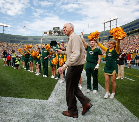 Former Green Bay Packers quarterback Bart Starr is introduced at halftime of a game between the Packers and the Buffalo Bills in 2010.