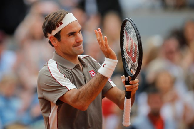 Switzerland's Roger Federer celebrates his victory over Italy's Lorenzo Sonego during their first round match.