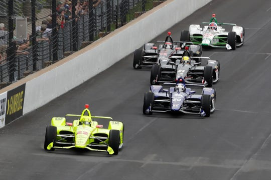 Simon Pagenaud leads a pack of cars during the Indy 500.