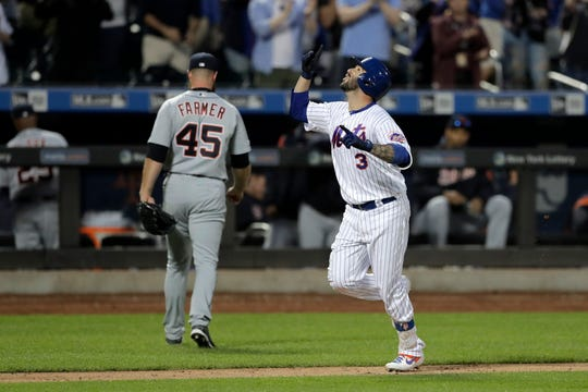 Mets' Tomas Nido, right, gestures while running the bases after hitting a walk-off solo home run off Tigers relief pitcher Buck Farmer (45) in the 13th inning on Saturday.
