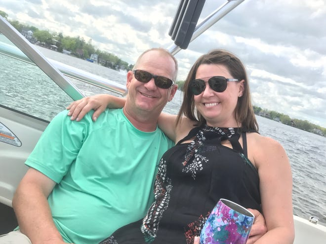 Tom Gillis and wife Jenny took advantage of his slight gaffe this weekend to enjoy some Memorial Day fun on the lake in Lake Orion.