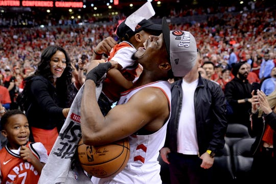 Raptors guard Kyle Lowry celebrates with one of his sons after beating the Bucks in six games in the Eastern Conference Finals.