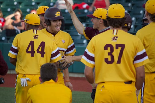 Central Michigan's Griffin Lockwood-Powell celebrates after his two-run home run in the first inning on Saturday.