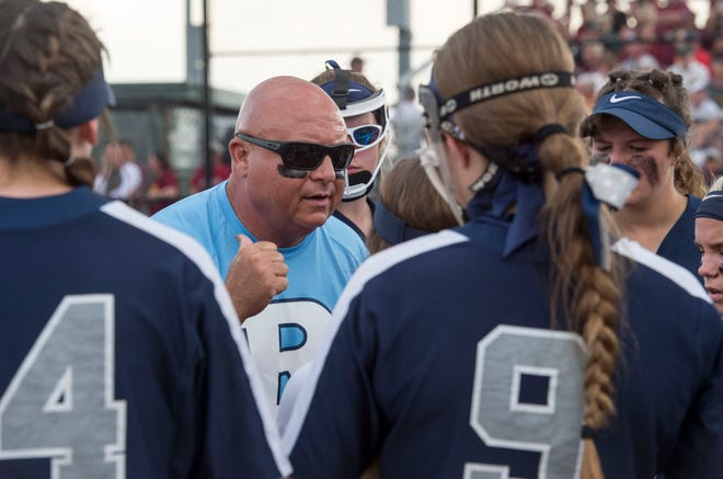 Reitz's Head Coach Allen Woodruff  gives direction during the 2019 IHSAA 4A Girls Softball sectional championship game against the Gibson Southern Titans Saturday, May 25, 2019.