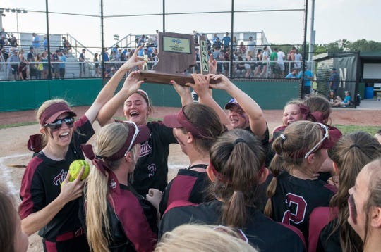 Gibson Southern Titans celebrate after beating the Reitz Panthers during the IHSAA Class 4A Girls Softball Sectional game Saturday, May 25, 2019.