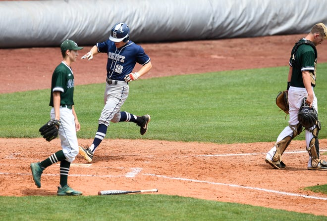 Reitz's Adam Euler (16) scores in the third inning as the Reitz Panthers play the North High Huskies in the Class 4A sectional semifinals at Evansville's Bosse Field Saturday, May 25, 2019.