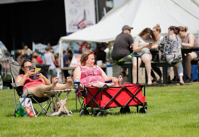 Rosie Basulto, left, and Barbie Lowis , both of Green Bay, soak in the sun during Celebrate De Pere in 2019 at the Brown County Fairgrounds. USA TODAY NETWORK-Wisconsin