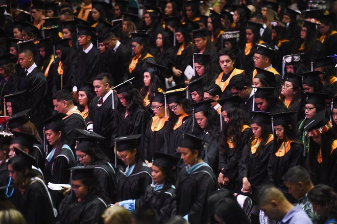 Three hundred seventy-five  students graduate during the University of Guam's Fañomnåkan 2019 Commencement at the UOG Calvo Field House in Mangilao, May 26, 2019