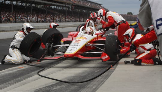 Josef Newgarden (2) and his crew during a pit stop Sunday during of the Indianapolis 500.