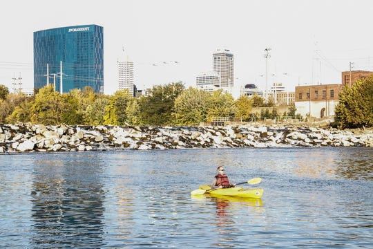 Boating is a popular activity in the White River. This man is shown in the river in a kayak near Downtown Indianapolis in October 2018.