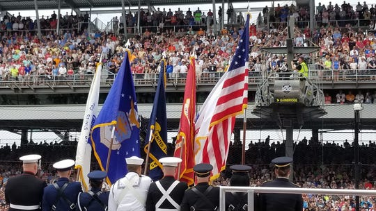 A color guard presents the flag prior to Kelly Clarkson singing the national anthem before the start of the Indianapolis 500 on Sunday, May 26, 2019.