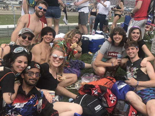 Ten University of Cincinnati students spend their Indy 500 Snake Pit on a hill at the back of the temporary venue inside Turn 3.