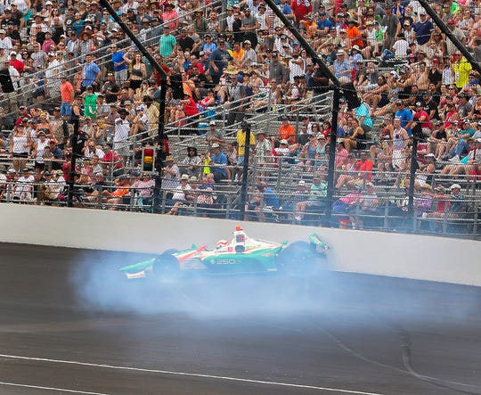 Kyle Kaiser (32) of Juncos Racing  spins and hits the wall betweens turns 3 and 4 during the start of the Indianapolis 500 at Indianapolis Motor Speedway on Sunday, May 26, 2019.