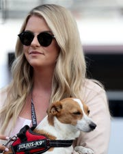 Hailey McDermott and her dog at the 103rd Indianapolis 500 at Indianapolis Motor Speedway on May 26, 2019.