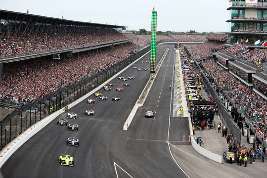The green flag drops as cars head toward the first turn at the start of the 2019 Indianapolis 500 at the Indianapolis Motor Speedway, Sunday, May 26, 2019.