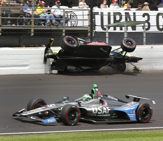 Sebastien Bourdais hits the Turn 3 wall on the 177th lap of the Indianapolis 500 on Sunday.