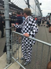 An Indy 500 fan wears a checkered suit.