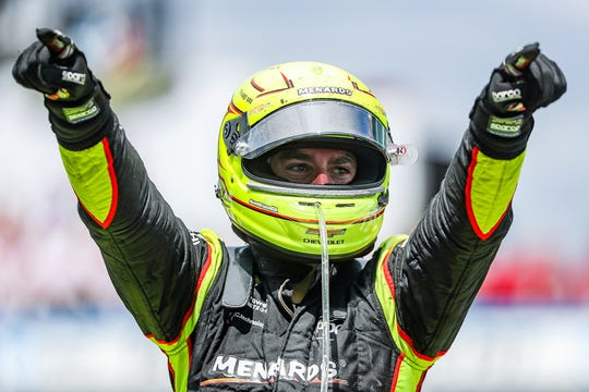 Simon Pagenaud (22) of Team Penske celebrates winning the 103rd running of the Indy 500 at Indianapolis Motor Speedway, Sunday, May 26, 2019.