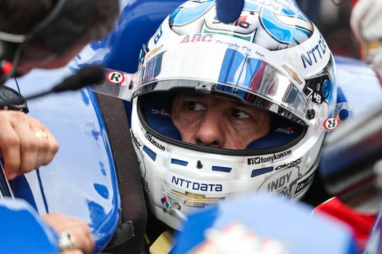 Tony Kanaan (14) of A.J. Foyt Enterprises prepares in his car on the grid before the start of the 103rd running of the Indy 500 at Indianapolis Motor Speedway, Sunday, May 26, 2019.