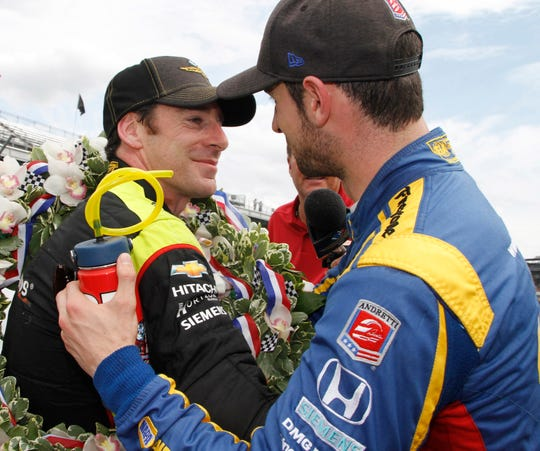 Alexander Rossi congratulates Simon Pagenaud after he won 2019 Indianapolis 500, Sunday, May 26, 2019.