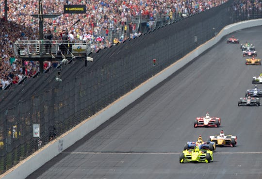 Simon Pagenaud (22) of Team Penske crosses the finish line to win the 103rd running of the Indianapolis 500, Sunday, May 26, 2019, in Speedway, Ind.