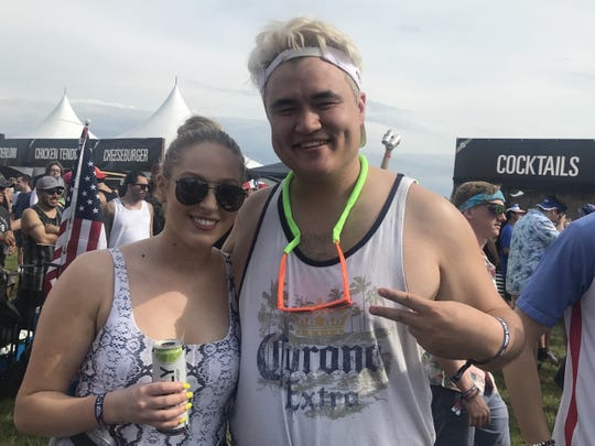 "Cincinnati residents Tori Meyer and Daniel ""Jumbo"" McHugh devised a party trick at Sunday's Indy 500 Snake Pit."