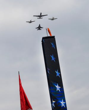 The flyover U.S. Air Force Heritage Team a F-16 Fighting Falcon, A-10 Thunderbolt II, P-51 Mustang and a P-40 Warhawk before the start of the Indianapolis 500 at Indianapolis Motor Speedway on Sunday, May 26, 2019.