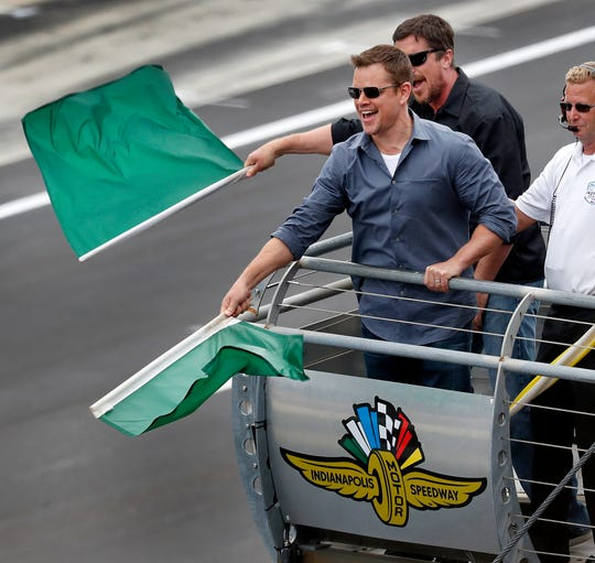 Actors Matt Damon and Christian Bale wave the green flags to start the103rd Indianapolis 500 at Indianapolis Motor Speedway on Sunday, May 26, 2019.