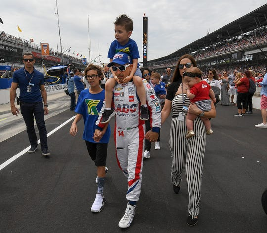 Tony Kanaan of A.J. Foyt Enterprises and his family before the start of the Indianapolis 500 at Indianapolis Motor Speedway on Sunday, May 26, 2019.