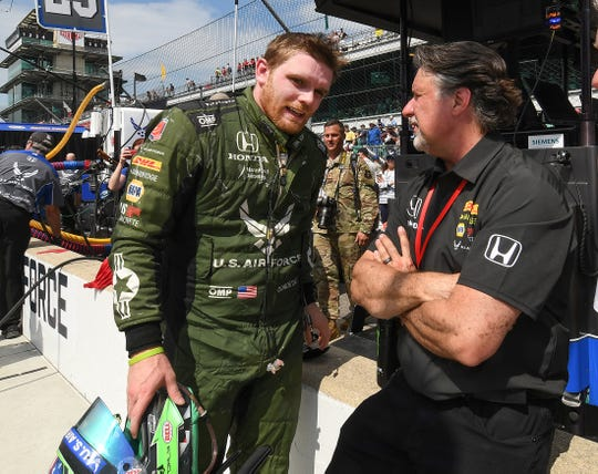 Conor Daly (25) of Andretti Autosport talks with Michael Andretti following the Indianapolis 500 at Indianapolis Motor Speedway on Sunday, May 26, 2019.