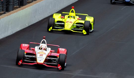 Josef Newgarden (2) takes the lead heading into the first turn on lap 151 during Sunday's running of the Indianapolis 500.