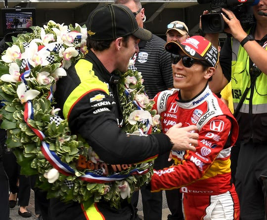 Takuma Sato congratulates Simon Pagenaud of Team Penske after winning the Indianapolis 500 at Indianapolis Motor Speedway on Sunday, May 26, 2019.