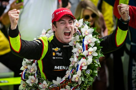 Simon Pagenaud (22) of Team Penske celebrates winning the Indianapolis 500, Sunday, May 26, 2019, at Indianapolis Motor Speedway.