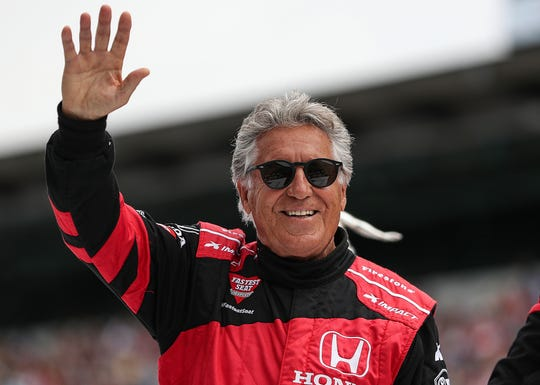 Mario Andretti is honored on the grid before the start of the 103rd running of the Indy 500 at Indianapolis Motor Speedway, Sunday, May 26, 2019.