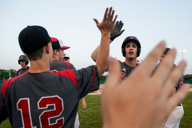 Lafayette Jeff's Christian Maggio high fives teammates during a baseball game last season. Maggio is a senior with no plans to play baseball beyond high school.