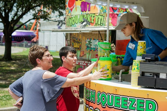 Families enjoy food, drinks, rides, games and more at the Cajun Heartland State Fair Saturday, May 25, 2019.