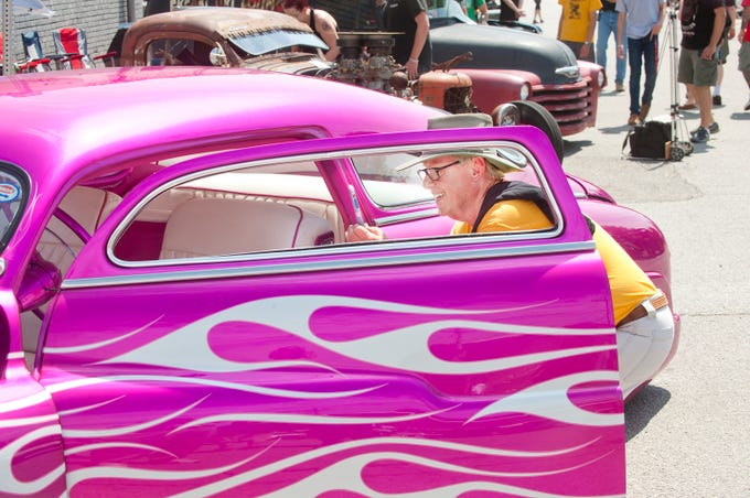 Monte King of Paris, Ky., takes a snap of this hot pink 1950s Mercury owned by Jeremy McCord of New Concord, Ky., on display at Beatersville, a pre-1968 hot rod and custom show held in Portland on Sunday. May 26, 2019