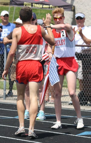 Caleb Brown (facing camera) and Sam Logan congratulate each other after finishing first and fourth, respectively, in the 3200 at the Division II regional track meet in Lexington.