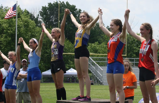 Freshman Ellie Maurer is all smiles atop the podium after winning a Division II regional title in the 1600.
