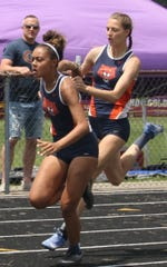 Kerrigan Myers hands the baton to Brooklyn Cosey as Galion wins the 4x100 relay. Between them, those two girls are going to state in five events.