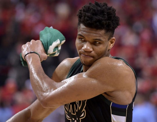 Bucks forward Giannis Antetokounmpo reacts after a turnover.