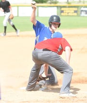 Viola's Andrew Cantway slides safely into third base during Mountain Home MacLeod's intrasquad scrimmage Saturday.