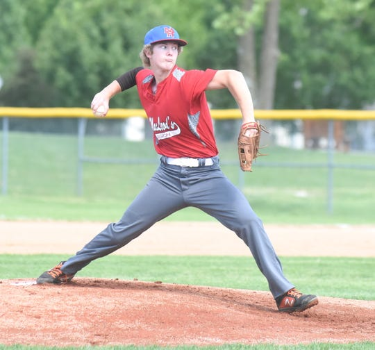 Carter Graves delivers to the plate for the MacLeod Junior Legion team on Saturday.