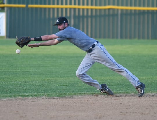 Shortstop Matt Prinner dives for a ground ball for the Lockeroom alumni team on Saturday night.