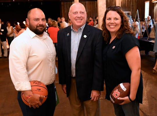 The Voice of Auburn Rod Bramblett takes a photo with fans at Auburn AMBUSH on Wednesday, May 1, 2019 in Dothan, Ala.